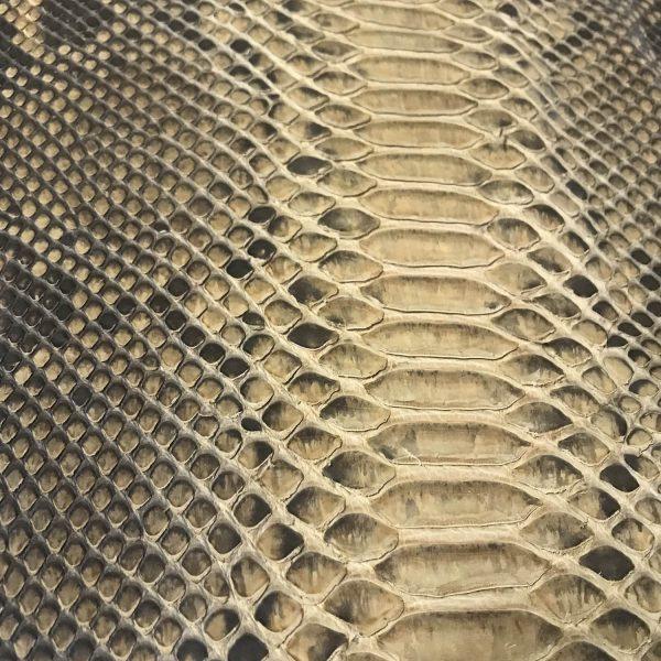 """SKU:10010 NAME:python leather matt beige almond ANIMAL:python leather SPECIE:reticulatus ARTICLE:matt COLOR:beige almond USE:leathergoods, shoes SIZE:23/27 THICKNESS:0,4/0,6 DESCRIPTION:soft, matt, waxy """
