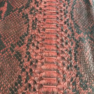 """""""SKU:10065 NAME:python leather oil rusty red ANIMAL:python leather SPECIE:reticulatus ARTICLE:oil COLOR:rusty red USE:leathergoods, shoes, garment SIZE:27+;30+ THICKNESS:0,4/0,6 DESCRIPTION:soft, matt, waxy """""""