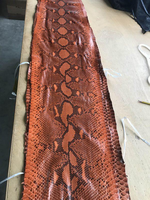 """SKU:10068 NAME:python leather acquarello lux brick orange ANIMAL:python leather SPECIE:reticulatus ARTICLE:acquarello lux COLOR:brick orange USE:leathergoods, shoes SIZE:27+;30+ THICKNESS:0,4/0,6 DESCRIPTION:soft, semishinny """