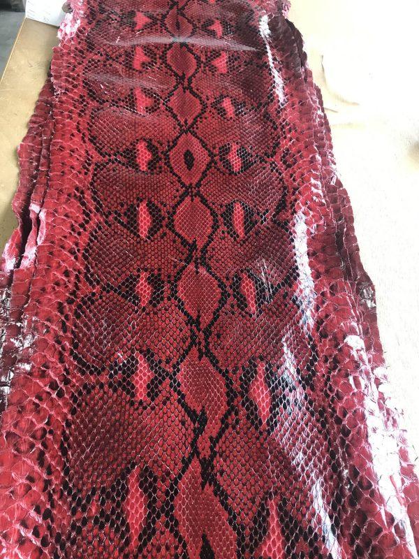 """SKU:10077 NAME:python leather acquarello lux melagrana red ANIMAL:python leather SPECIE:reticulatus ARTICLE:acquarello lux COLOR:melagrana red USE:leathergoods, shoes SIZE:27+ THICKNESS:0,4/0,6 DESCRIPTION:soft, semishinny """