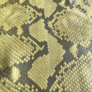 """""""SKU:10082 NAME:python leather oil cardamom ANIMAL:python leather SPECIE:reticulatus ARTICLE:oil COLOR:cardamom USE:leathergoods, shoes, garment SIZE:27+; 30+; THICKNESS:0,4/0,6 DESCRIPTION:soft, matt, waxy """""""