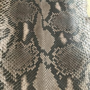 """""""SKU:10087 NAME:python leather oil pink tan ANIMAL:python leather SPECIE:reticulatus ARTICLE:oil COLOR:pink tan USE:leathergoods, shoes, garment SIZE:27+; 30+; 33+ THICKNESS:0,4/0,6 DESCRIPTION:soft, matt, waxy """""""