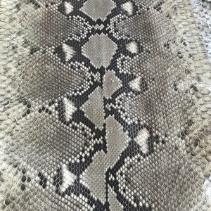 """""""SKU:10089 NAME:python leather moon lux dk sand ANIMAL:python leather SPECIE:reticulatus ARTICLE:moon lux COLOR:dk sand USE:leathergoods, shoes SIZE:27+; 30+; 33+ THICKNESS:0,4/0,6 DESCRIPTION:soft, matt, waxy """""""