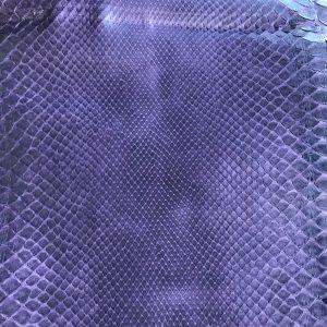"""SKU:10095 NAME:python leather dakota violet 56 ANIMAL:python leather SPECIE:reticulatus ARTICLE:dakota COLOR:violet 56 USE:leathergoods, shoes SIZE:27-; 27+ THICKNESS:0,4/0,6 DESCRIPTION:soft, matt, waxy """