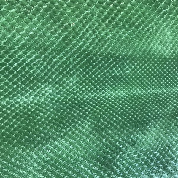 """""""SKU:10098 NAME:python leather soft bleatched palm green ANIMAL:python leather SPECIE:moluro ARTICLE:soft bleatched COLOR:palm green USE:leathergoods, shoes, garment SIZE:27+ THICKNESS:0,4/0,6 DESCRIPTION:soft, shinny """""""