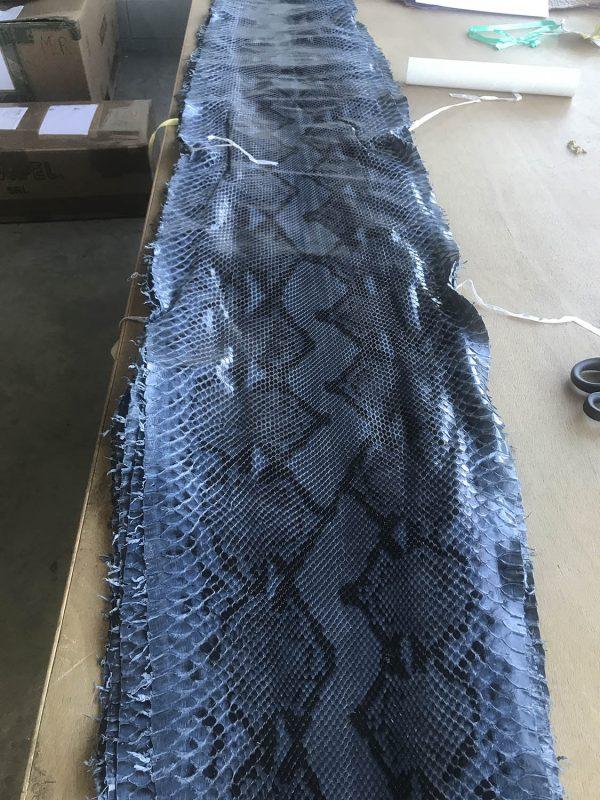 """SKU:10120 NAME:python leather superlux caspian ANIMAL:python leather SPECIE:reticulatus ARTICLE:superlux COLOR:caspian USE:leathergoods, shoes SIZE:30+ THICKNESS:0,4/0,6 DESCRIPTION:soft, semishinny """