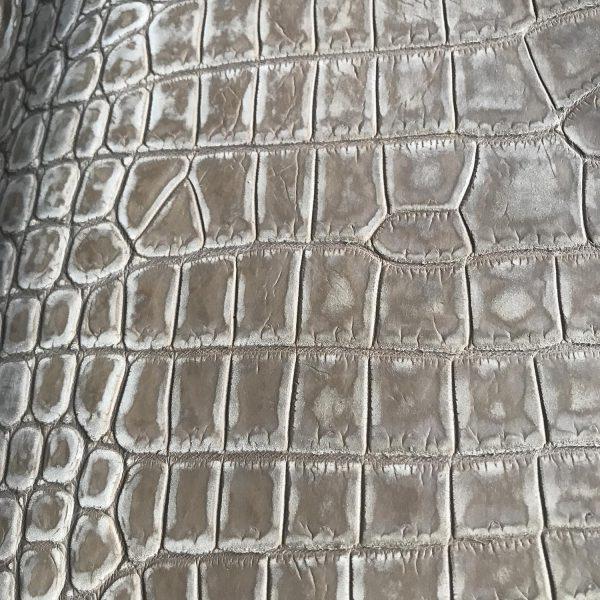 """SKU:10134 NAME:crocodile leather nabuck tortora ANIMAL:crocodile leather SPECIE:niloticus ARTICLE:nabuck COLOR:tortora USE:leathergoods, shoes, garment SIZE:35-39, 40-44 THICKNESS:1,0/1,2 DESCRIPTION:matt, soft, dressy """