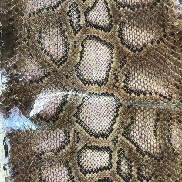 """""""SKU:10156 NAME:python leather naif pink brown ANIMAL:python leather SPECIE:moluro ARTICLE:naif COLOR:pink brown USE:leathergoods, shoes, garment SIZE:27+, 30+ THICKNESS:0,4/0,6 DESCRIPTION:soft, matt """""""