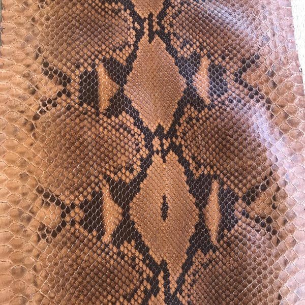 """""""SKU:10181 NAME:python leather moon lux brandy ANIMAL:python leather SPECIE:reticulatus ARTICLE:moon lux COLOR:brandy USE:leathergoods, shoes SIZE:27- THICKNESS:0,4/0,6 DESCRIPTION:soft, shinny """""""
