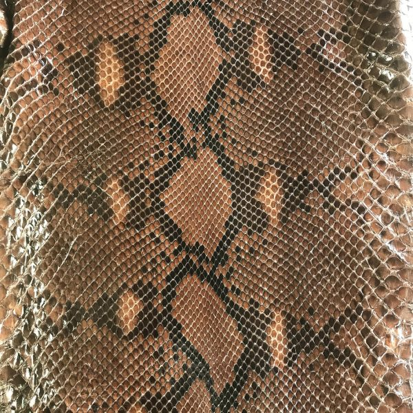 """""""SKU:10182 NAME:python leather moon lux cuir ANIMAL:python leather SPECIE:reticulatus ARTICLE:moon lux COLOR:cuir USE:leathergoods, shoes SIZE:27- THICKNESS:0,4/0,6 DESCRIPTION:soft, shinny """""""