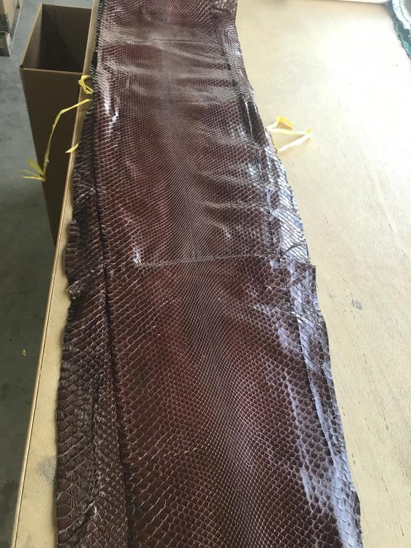 """""""SKU:10184 NAME:python leather bleatched millenium newchocolate ANIMAL:python leather SPECIE:moluro ARTICLE:bleatched millenium COLOR:newchocolate USE:leathergoods, shoes, garment SIZE:27-, 27+ THICKNESS:0,4/0,6 DESCRIPTION:soft, shinny """""""