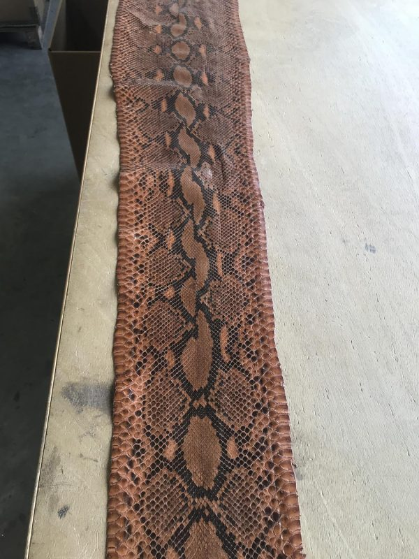 """""""SKU:10187 NAME:python leather moon lux brandy ANIMAL:python leather SPECIE:reticulatus ARTICLE:moon lux COLOR:brandy USE:leathergoods, shoes SIZE:27-, 27+ THICKNESS:0,4/0,6 DESCRIPTION:soft, shinny """""""