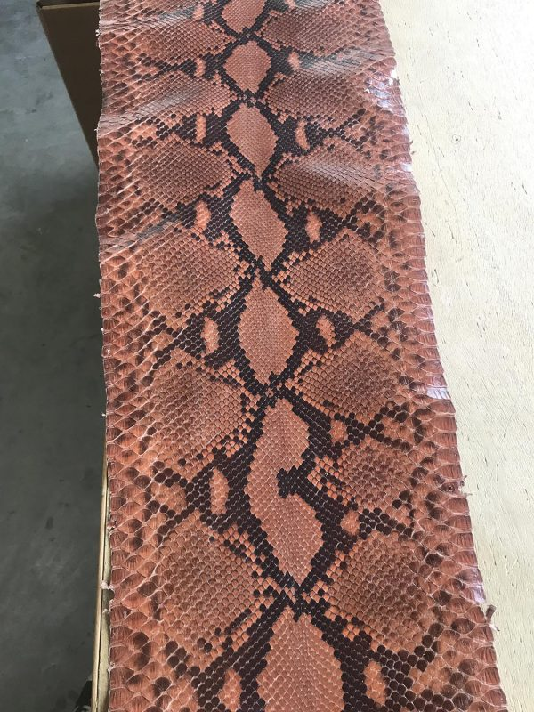 """""""SKU:10188 NAME:python leather moon lux corrosion ANIMAL:python leather SPECIE:reticulatus ARTICLE:moon lux COLOR:corrosion USE:leathergoods, shoes SIZE:27-, 27+ THICKNESS:0,4/0,6 DESCRIPTION:soft, shinny """""""