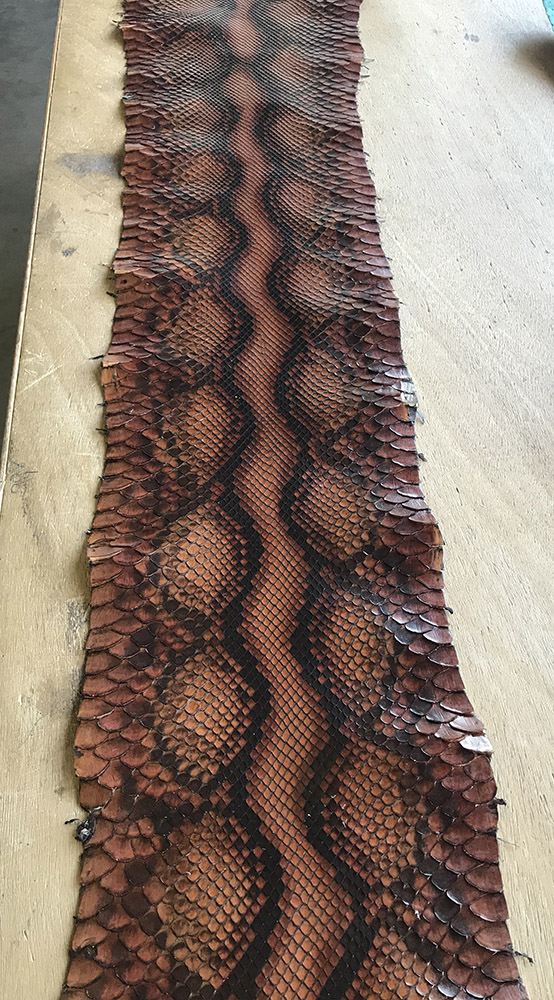 """SKU:10228 NAME:python leather glace deep carminio ANIMAL:python leather SPECIE:reticulatus ARTICLE:glace COLOR:deep carminio USE:leathergoods, shoes SIZE:27+;30+ THICKNESS:0,4/0,6 DESCRIPTION:soft, semishinny """