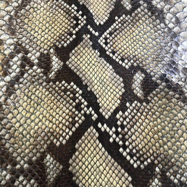 """SKU:10232 NAME:python leather glace porridge ANIMAL:python leather SPECIE:reticulatus ARTICLE:glace COLOR:porridge USE:leathergoods, shoes SIZE:27+;30+ THICKNESS:0,4/0,6 DESCRIPTION:soft, semishinny """