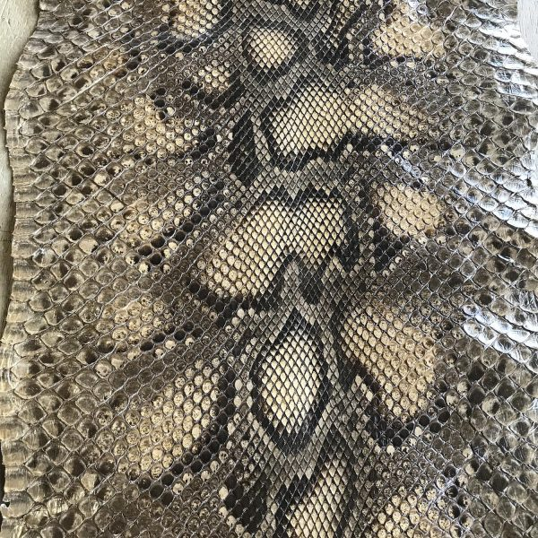 """""""SKU:10240 NAME:python leather pearl lux warm ANIMAL:python leather SPECIE:moluro ARTICLE:pearl COLOR:lux warm USE:leathergoods, shoes, garment SIZE:27-, 27+, THICKNESS:0,4/0,6 DESCRIPTION:soft, shinny """""""
