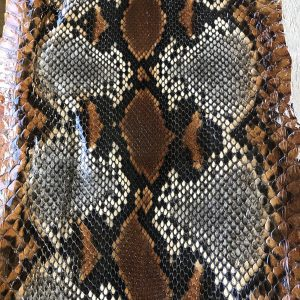 """SKU:10246 NAME:python leather tutti frutti roccia marrone ANIMAL:python leather SPECIE:reticulatus ARTICLE:tutti frutti COLOR:roccia marrone USE:leathergoods, shoes, garment SIZE:27-,27+ THICKNESS:0,4/0,6 DESCRIPTION:soft, shinny """