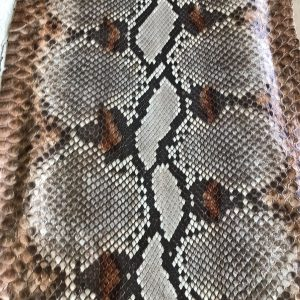 """SKU:10247 NAME:python leather namib miele ANIMAL:python leather SPECIE:reticulatus ARTICLE:namib COLOR:miele USE:leathergoods, shoes, garment SIZE:27-,27+ THICKNESS:0,4/0,6 DESCRIPTION:soft, shinny """